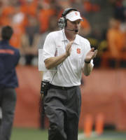 Syracuse coach Scott Shafer applauds during the quarter of an NCAA college football against Wagner in the Carrier Dome in Syracuse, N.Y., Saturday, Sept. 14, 2013. (AP Photo/Nick Lisi)