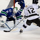 Vancouver Canucks' goalie Eddie Lack, left, of Sweden, stops Los Angeles Kings' Marian Gaborik, of Slovakia, during second period NHL hockey action in Vancouver, British Columbia, on Saturday April 5, 2014 The Associated Press