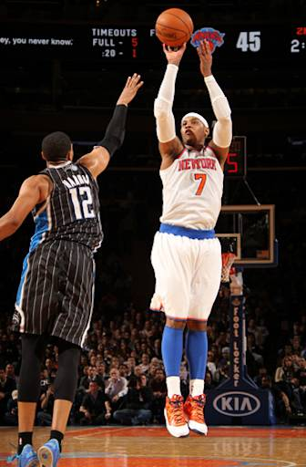 NEW YORK, NY - MARCH 20: Carmelo Anthony #7 of the New York Knicks shoots against Tobias Harris #12 of the Orlando Magic on March 20, 2013 at Madison Square Garden in New York City.  (Photo by Nathaniel S. Butler/NBAE via Getty Images)