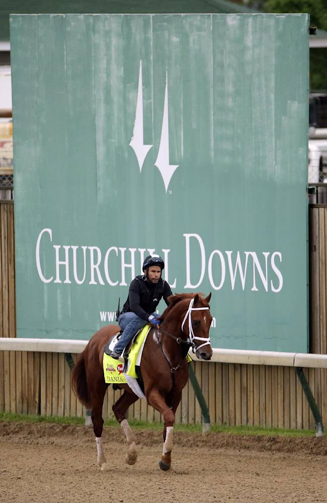 Exercise rider Ezequiel Perez takes Kentucky Derby hopeful Danza for a morning workout at Churchill Downs Wednesday, April 30, 2014, in Louisville, Ky