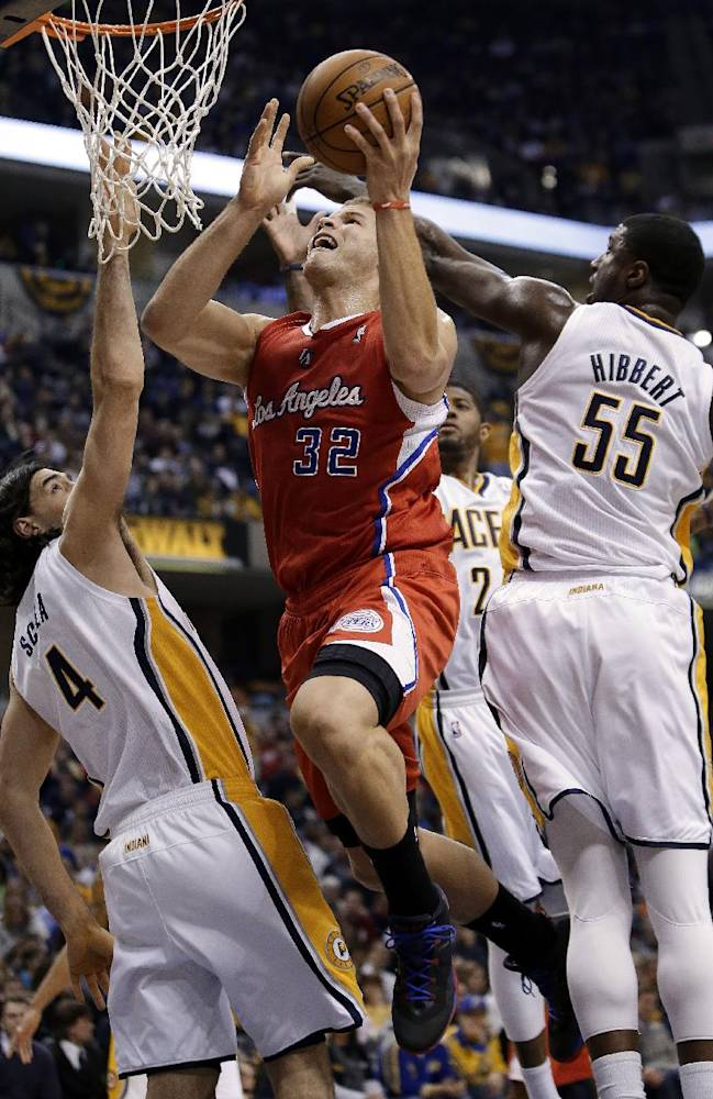 Los Angeles Clippers forward Blake Griffin (32) shoots between Indiana Pacers defenders Luis Scola (4) and Roy Hibbert (55) during the first half of an NBA basketball game in Indianapolis, Saturday, Jan. 18, 2014