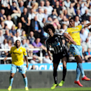 Newcastle United's captain Fabricio Coloccini, left, vies for the ball with Crystal Palace's Marouane Chamakh, right, during their English Premier League soccer match at St James' Park, Newcastle, England, Saturday, Aug. 30, 2014