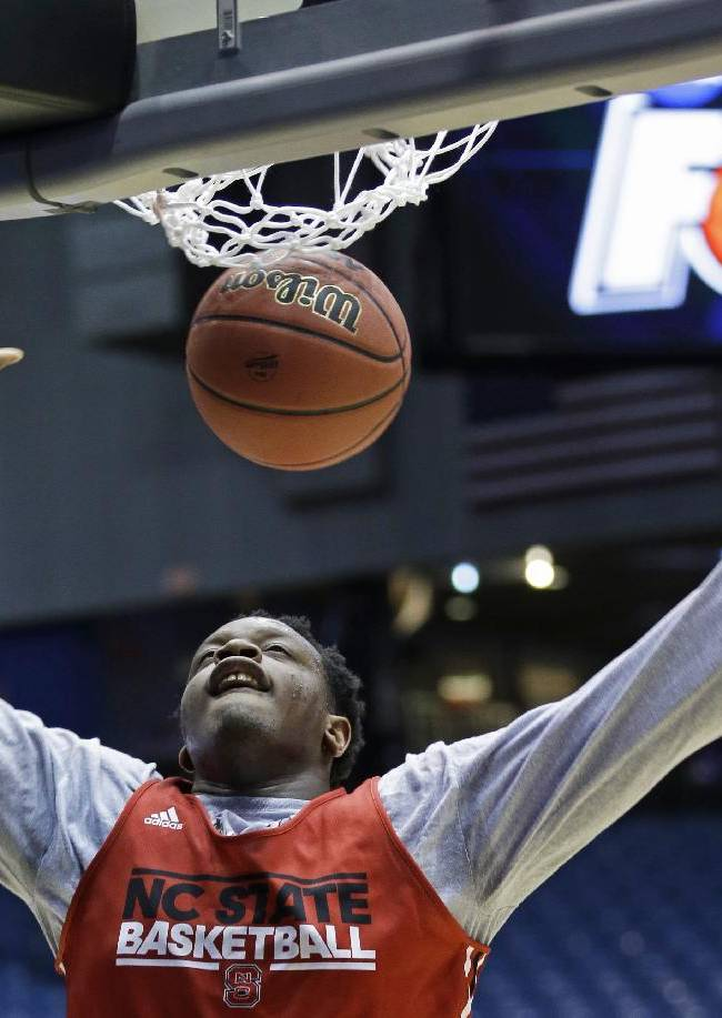 North Carolina State forward Beejay Anya dunks during practice for an NCAA college basketball tournament game, Monday, March 17, 2014, in Dayton, Ohio. NC State plays Xavier on Tuesday in a first round game
