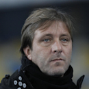 Rio Ave's coach Pedro Martins awaits the start of the Europa League Group J soccer match between Dynamo Kiev and Rio Ave at the Olympiyskiy national stadium in Kiev, Ukraine, Thursday, Nov. 27, 2014 The Associated Press