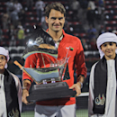 Roger Federer of Switzerland displays his trophy after beating Tomas Berdych of Czech Republic during the final match of the Dubai Duty Free Tennis Championships in Dubai, United Arab Emirates, Saturday, March 1, 2014. (AP Photo/Kamran Jebreili)