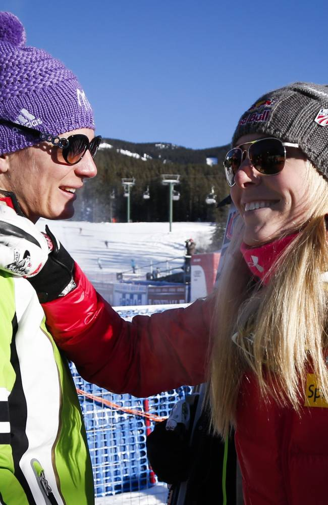 Germany's Maria Hoefl-Riesch, left, is congratulated by Lindsey Vonn, of the USA, following the women's World Cup downhill ski race in Lake Louise, Alberta, Saturday, Dec. 7, 2013. (AP Photo/The Canadian Press, Jeff McIntosh)