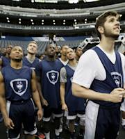 Connecticut players look around the stadium as they arrive to practice for their NCAA Final Four tournament college basketball semifinal game Friday, April 4, 2014, in Dallas. Connecticut plays Florida on Saturday, April 5, 2014. (AP Photo/Charlie Neibergall)