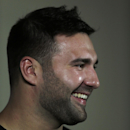 New England Patriots defensive end Rob Ninkovich smiles as he answers a question during a football news conference at Gillette Stadium in Foxborough, Mass., Wednesday, July 23, 2014. Players reported to training camp with their first team practice schedul