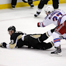 New York Rangers' Ryan McDonagh (27) checks Pittsburgh Penguins' Nick Spaling off the puck during the third period of an NHL hockey game, Sunday, Jan. 18, 2015, in Pittsburgh. The Rangers won 5-2 The Associated Press