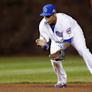 Chicago Cubs shortstop Starlin Castro fields a ball hit by the Arizona Diamondbacks' Martin Prado who grounded out during the eighth inning of a baseball game on Monday, April 21, 2014, in Chicago The Associated Press