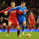 Liverpool's Lucas Leiva, left, and Sunderland's Adam Johnson battle for the ball battle for the ball during the English Premier League soccer match at Anfield, Liverpool, England, Saturday Dec. 6, 2014