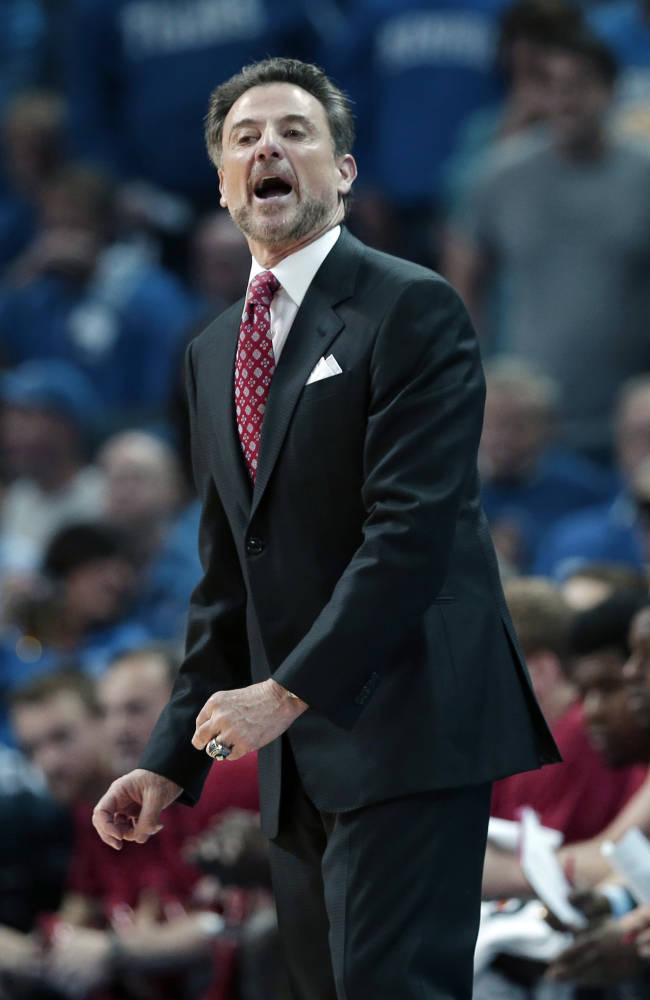 Louisville coach Rick Pitino shouts in the first half of an NCAA college basketball game against Memphis in Memphis, Tenn., Saturday, March 1, 2014