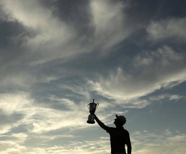 Justin Rose, of England, poses with the trophy after winning the U.S. Open golf tournament at Merion Golf Club, Sunday, June 16, 2013, in Ardmore, Pa