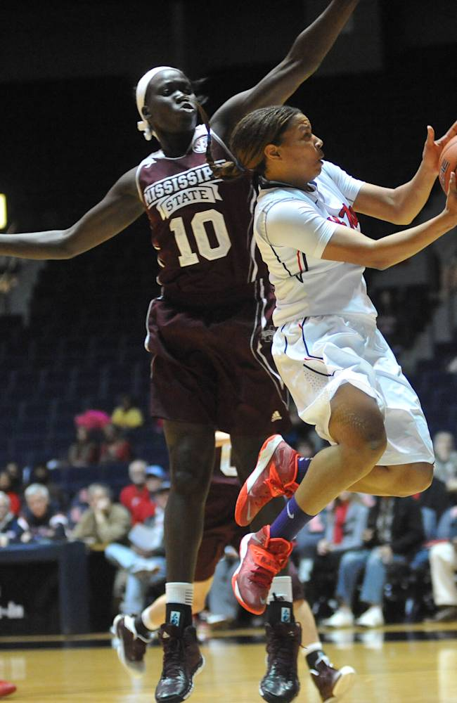 Mississippi's Diara Moore, right, shoots against Mississippi State's Martha Alwal (10) during an NCAA college basketball game Thursday, Jan. 23, 2014, in Oxford, Miss