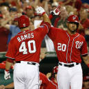 Washington Nationals' Wilson Ramos (40) celebrates his solo home run with Ian Desmond (20) during the sixth inning of a baseball game against the San Francisco Giants at Nationals Park, Sunday, July 5, 2015, in Washington. (AP Photo/Alex Brandon)