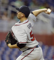 Atlanta Braves starting pitcher Freddy Garcia throws in the first inning during a baseball game against the Miami Marlins, Thursday, Sept. 12, 2013, in Miami. (AP Photo/Lynne Sladky)