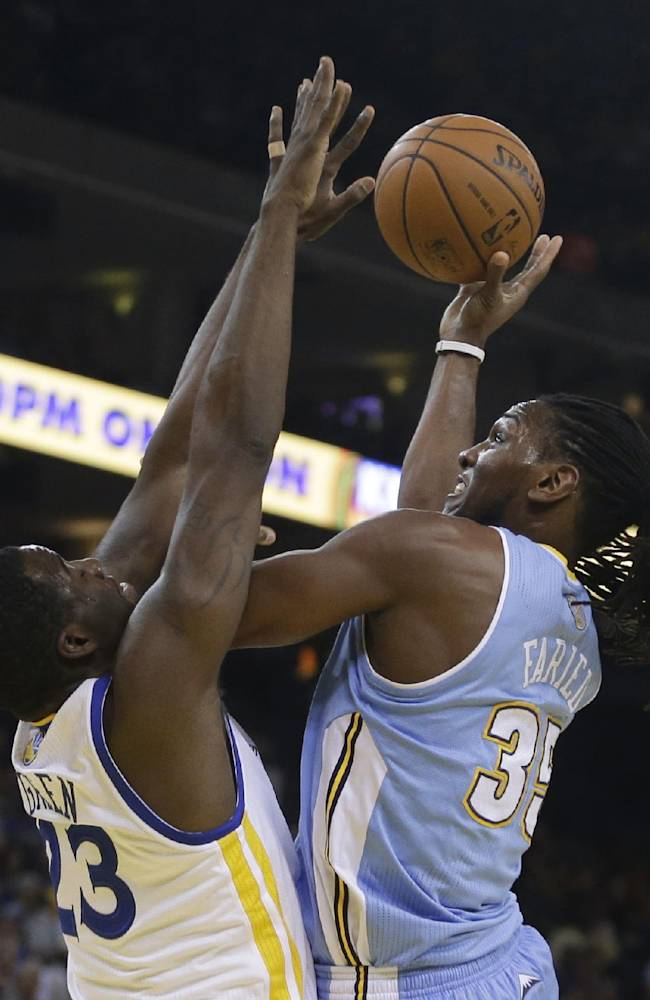 Denver Nuggets' Kenneth Faried, right, shoots against Golden State Warriors' Draymond Green during the first half of an NBA basketball game Thursday, April 10, 2014, in Oakland, Calif