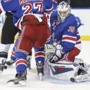 New York Rangers goalie Henrik Lundqvist (30) makes a save during the first period of their NHL hockey game against the Pittsburgh Penguins, Wednesday, Dec. 18, 2013, in New York. (AP Photo/John Minchillo)