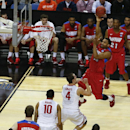 Dayton's Vee Sanford (43) shoots over Ohio State's Aaron Craft (4) during the second half of a second-round game in the NCAA college basketball tournament in Buffalo, N.Y., Thursday, March 20, 2014. Dayton won the game 60-59 The Associated Press
