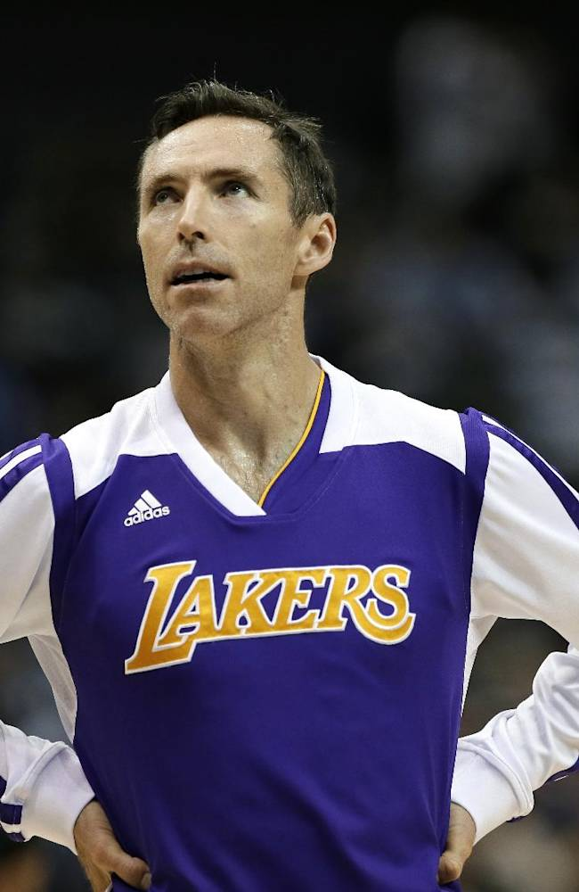 Los Angeles Lakers point guard Steve Nash (10) on the court during warm ups before an NBA basketball game against the Dallas Mavericks, Tuesday, Nov. 5, 2013, in Dallas. The Mavericks won 123-104