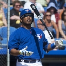 Toronto Blue Jays DH Edwin Encarnacion tosses his bat after a strike against the Pittsburgh Pirates during the third inning of a spring training exhibition baseball game, Tuesday, March 3, 2015, in Dunedin, Fla. (AP Photo/The Canadian Press, Nathan Denette)