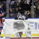 New York Rangers goalie Henrik Lundqvist, right, talks to teammate Anton Stralman (6) after the net was knocked over during the second period of an NHL hockey game against the Detroit Red Wings, Sunday, March 9, 2014, in New York. (AP Photo/Frank Franklin II)