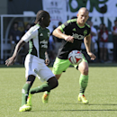 Seattle Sounders Chad Barrett, right, vies for control of the ball against Portland Timbers Diego Chara during an MLS soccer match in Portland, Ore., Sunday, Aug. 24, 2014. The Sounders won the game 4 to 1 The Associated Press