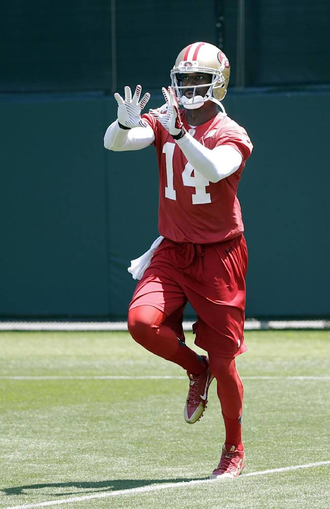 CORRECTS NAME TO KASSIM OSGOOD, INSTEAD OF BRANDON LLOYD - San Francisco 49ers receiver Kassim Ogdood makes a catch during an NFL football organized team activity, Tuesday, June 3, 2014, in Santa Clara, Calif