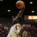 San Diego State's Winston Shepard, left, tries to shoot as Cal State Bakersfield's Justin Omogun, right, puts a hand on his face in the first half during an NCAA college basketball game on Wednesday, Jan. 2, 2013, in San Diego. (AP Photo/Gregory Bull)