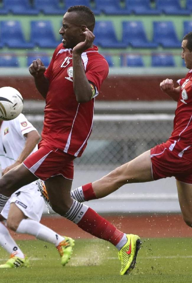 Myanmar's David Htan, left, battles for ball against Palestine's Abdallatif M.S. Albahdari, center, and Abdallah N.A. Jaber  during the Peace Cup 2014 friendly soccer match between Myanmar and Palestine at the Rizal Memorial Football Stadium Wednesday, Sept. 3, 2014 in Manila, Philippines. Myanmar beat Palestine 4-1 to advance to the finals