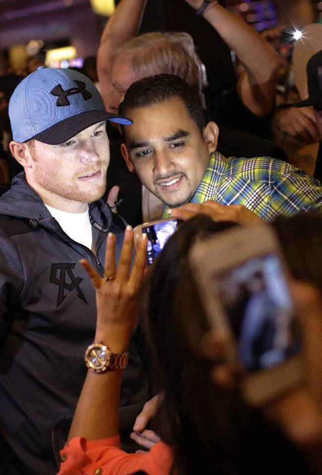 Boxer Canelo Alvarez, in blue hat, meets with fans Wednesday, July 9, 2014, in Las Vegas. Alvarez is scheduled to fight Erislandy Lara in a super welterweight boxing fight Saturday in Las Vegas