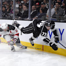 Los Angeles Kings center Jeff Carter, right, trips over New Jersey Devils defenseman Andy Greene during the second period of an NHL hockey game, Wednesday, Jan. 14, 2015, in Los Angeles The Associated Press