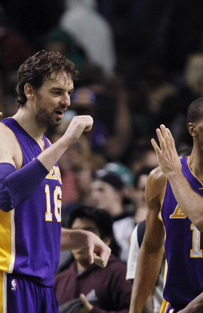 Los Angeles Lakers center Pau Gasol (16) celebrates with teammates after defeating the Boston Celtics 107-104 in an NBA basketball game in Boston, Friday, Jan. 17, 2014. Gasol had 24 points and 13 rebounds in the win