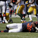 Chicago Bears defensive back Ahmad Dixon (36) stays down on the ground after an injury in the first half of an NFL football game Sunday, Sept. 28, 2014, in Chicago. The Associated Press