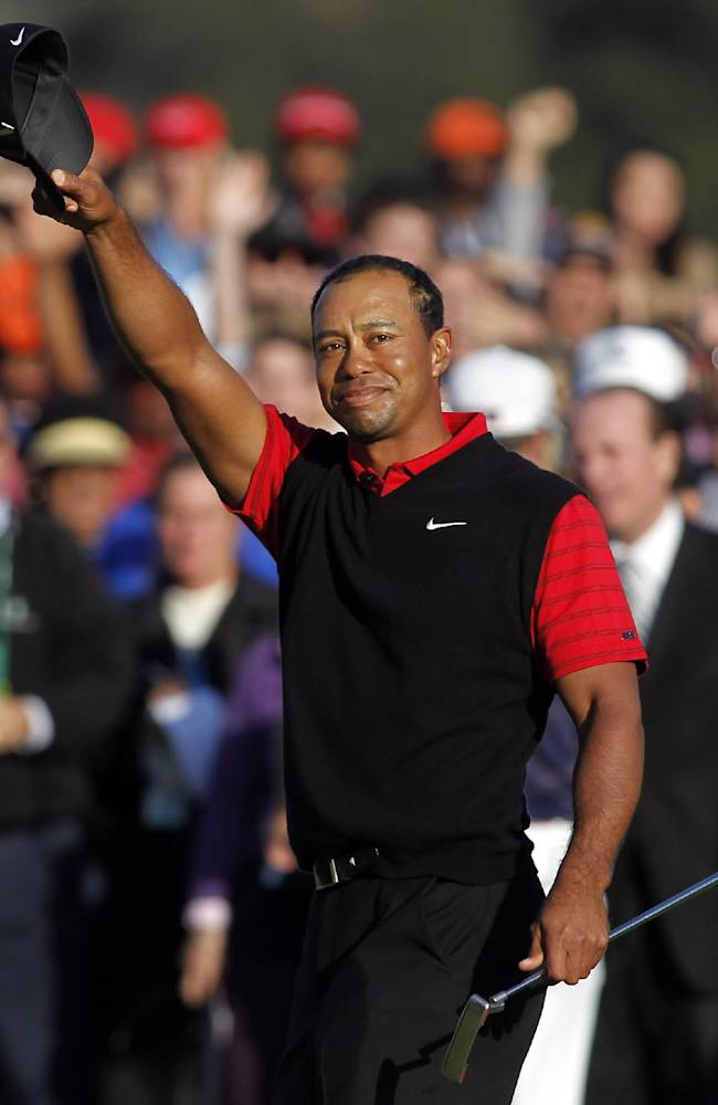 In this Dec. 4, 2011 file photo, Tiger Woods waves his cap after winning the Chevron World Challenge golf tournament at Sherwood Country Club in Thousand Oaks, Calif. Woods never won what he often referred to as his
