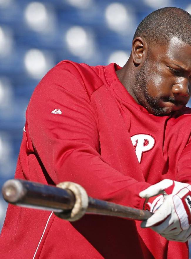 Philadelphia Phillies first baseman Ryan Howard swings a weighted bat while warming up before a spring exhibition baseball game against the New York Yankees in Clearwater, Fla., Thursday, March 13, 2014