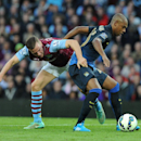 Aston Villa's Tom Cleverley, left, and Manchester City's Fernandinho in action during their English Premier League soccer match between Aston Villa and Manchester City at Villa Park, Birmingham, England, Saturday, Oct. 4, 2014