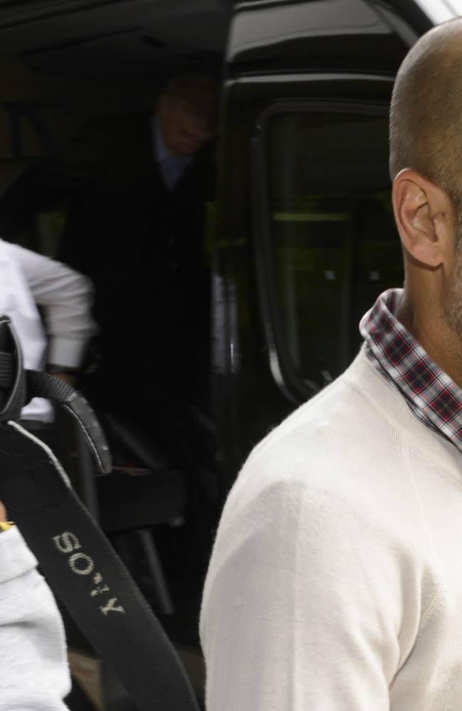 Bayern Munich's soccer  coach Pep  Guardiola arrives at the 16.  Elite Club Coaches Forum at the UEFA Headquarters in Nyon, Switzerland, Thursday, Sept. 4, 2014