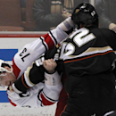 Carolina Hurricanes defenseman Brett Bellemore (73) fights with Anaheim Ducks left wing Patrick Maroon (62) during the third period of an NHL hockey game Sunday, March 2, 2014, in Anaheim, Calif. The Ducks won 5-3 The Associated Press
