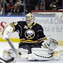 Buffalo Sabres' Ryan Miller makes a save against the Boston Bruins during the second period of an NHL hockey game in Buffalo, N.Y., Thursday, Dec. 19, 2013. (AP Photo/Gary Wiepert)