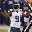 Seattle Seahawks defensive end Chris Clemons (91) reacts to a defensive play against Denver Broncos during the second half of the NFL Super Bowl XLVIII football game Sunday, Feb. 2, 2014, in East Rutherford, N.J. The Seahawks won 43-8 The Associated Press