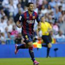 Barcelona's Luis Suarez, celebrates after Barcelona's Neymar scored during a Spanish La Liga soccer match between Real Madrid and Barcelona at the Santiago Bernabeu stadium in Madrid, Spain, Saturday Oct. 25, 2014. (AP Photo/Paul White)