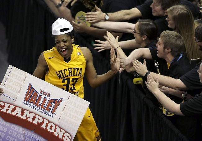 Wichita State's Michelle Price, left, celebrates with members of the Wichita State pep band following an NCAA college basketball game against Drake in the championship of the Missouri Valley Conference women's tournament Sunday, March 16, 2014, in St. Charles, Mo. Wichita State won 73-49
