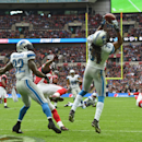 Detroit Lions cornerback Rashean Mathis (31) catches the ball before running the length of the field to score a touchdown which was disallowed for a foul on Atlanta Falcons wide receiver Julio Jones (11), centre, during the NFL football game at Wembley St