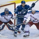 New York Rangers defenseman Dan Girardi (5) tries to clear Vancouver Canucks left wing Alex Burrows (14) from in front of New York Rangers goalie Henrik Lundqvist (30) during the third period of an NHL hockey game, Saturday, Dec. 13, 2014 in Vancouver, Br