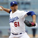 Los Angeles Dodgers starting pitcher Josh Beckett (61) throws against the Chicago Cubs in the first inning of a baseball game on Sunday, Aug. 3, 2014, in Los Angeles The Associated Press