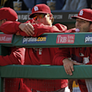 St. Louis Cardinals pitchers Lance Lynn, right, Shelby Miller, center, and Joe Kelly lean on the dugout railing during the ninth inning of a baseball game against the Pittsburgh Pirates in Pittsburgh Sunday, April 6, 2014. None of the three pitched in the