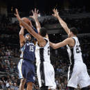 SAN ANTONIO - DECEMBER 17: Vince Carter #15 of the Memphis Grizzlies takes a shot against the San Antonio Spurs at the AT&T Center on December 17, 2014 in San Antonio, Texas