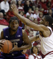 Northwestern's JerShon Cobb (23) goes to the basket against Indiana's Evan Gordon during the first half of an NCAA college basketball game Saturday, Jan. 18, 2014, in Bloomington, Ind. (AP Photo/Darron Cummings)