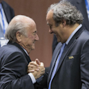 FILE - In this Friday, May 29, 2015 file photo, FIFA president Sepp Blatter after his election as President, left is greeted by UEFA President Michel Platini, right, at the Hallenstadion in Zurich, Switzerland. Michel Platini has launched his campaign to succeed Sepp Blatter as FIFA president, aiming to give the scandal-hit governing body